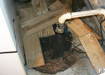 An ugly, clogged sump pump system in Weymouth, Massachusetts and Rhode Island