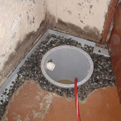 Installing a sump in a sump pump liner in a Framingham home