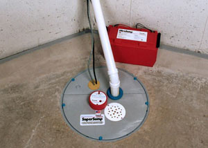 A sump pump system with a battery backup system installed in Newton