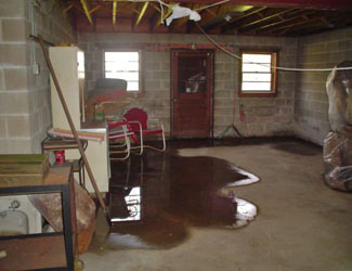 a flooded basement floor in a Westport home