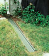 A recessed gutter drain extension installed in Westport, Massachusetts and Rhode Island